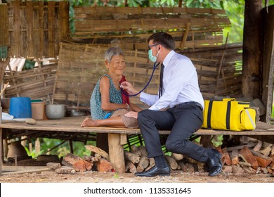 Older women happiness with healthcare of doctor visit home concept in Thailand. Native America young are doctor working in Asia.