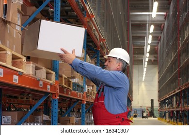 older worker in uniform moving,taking out,putting,segregating,lifting on (from) shelves in warehouse
