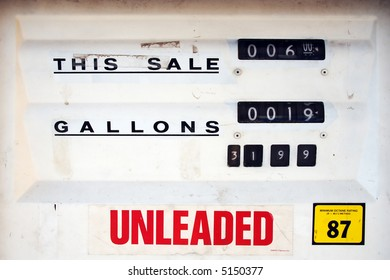 Older-style gas pump with dial display. Unleaded. White face with black dials.