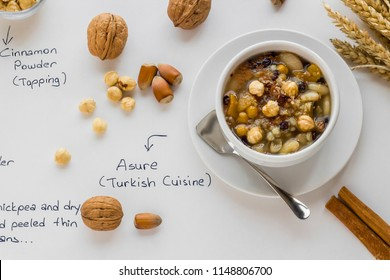 The Oldest Dessert In The World,Asure or Ashura(Noah Pudding)traditional dessert in white bowl on the white surface with ingredients.Handwriting Asure and Turkish Cuisine on white surface.Top view.