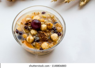 The Oldest Dessert In The World,Asure or Ashura(Noah Pudding)traditional dessert in transparent glass bowl on the white ground.