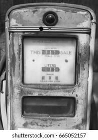 Oldest gas dispenser machine black and white color.