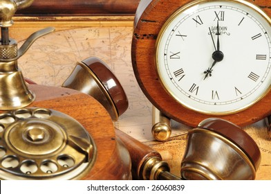 old-fashion objects as background: wooden clock and telephone