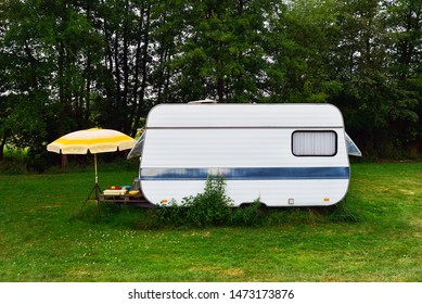Old-fashioned 1980s caravans on a camping site in Belgium.
