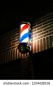 Old-fashioned barber pole in the night