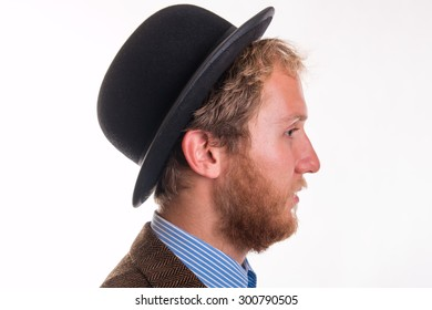 Old-fashioned bearded man with a beard and hat- studio shots