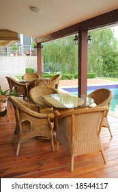 old-fashioned cane chairs and table in the garden