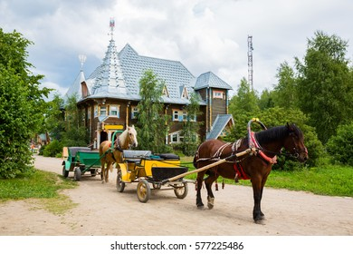 Old-fashioned carriage in the russian tourist center Verhnie Mandrogi. Center serves tourists and cruise the passenger ships by the river Svir in Russia.