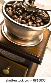 Old-fashioned coffee grinder with coffee beans