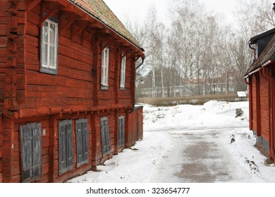 Old-fashioned cottage painted in swedish traditional red color.