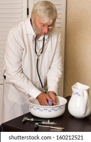 Old-fashioned doctor washing his hands in a basin