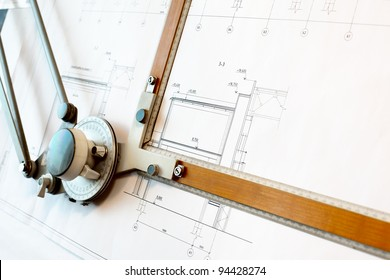 Old-fashioned drawing board with white project blueprint