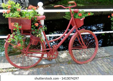 Old-fashioned Dutch city bike near a bridge over canal in the Old Town of Delft, Holland