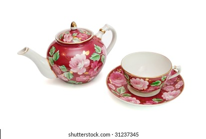 Old-fashioned floral-painted tea service isolated