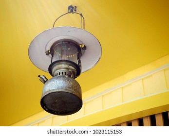 Old-fashioned lamp hanging on the ceiling yellow.