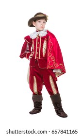 Old-fashioned little boy posing in luxury red musketeer suit. Isolated on white