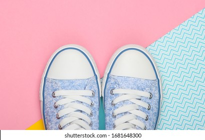 Old-fashioned retro sneakers on a colored background. Pastel color trend. Top view