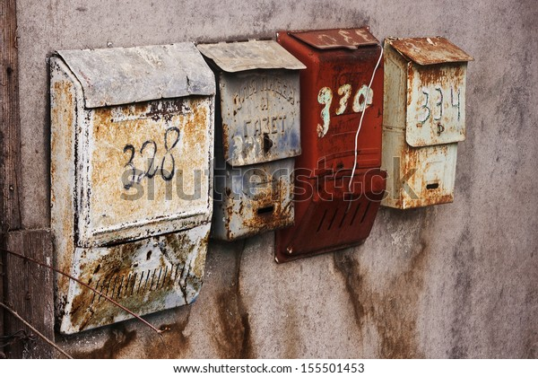 Old-fashioned russian mailboxes on the stucco wall