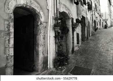 Old-fashioned street in Italy. Black in white image