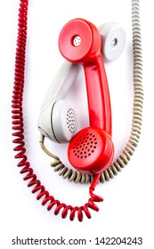 Old-fashioned telephone receivers with cord