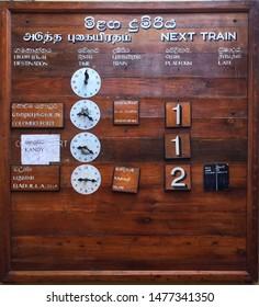 Old-fashioned train timetable at a Sri Lanka trainstation
