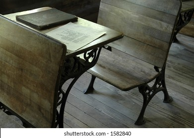 An old-fashioned wooden desk in a one-room school.