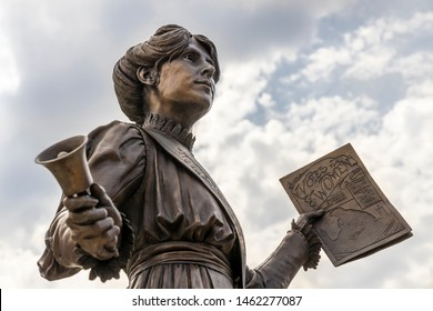 OLDHAM, UK - July 25, 2019: Statue of Annie Kenny political activist and homegrown suffragette for the Women's Social and Political Union in the centre of Oldham, England.