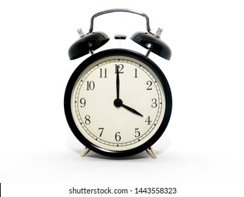 Old-style alarm clock, black and white, it's four o'clock.