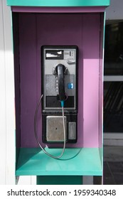 An old-style payphone attached to the wall.