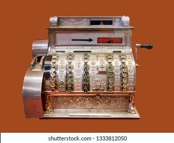 Old-time cash register, isolated on background. Vintage cash register.