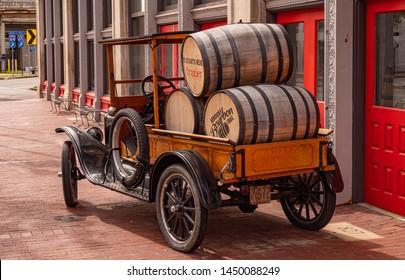 Oldtimer car with Bourbon barrels in Louisville - LOUISVILLE, KENTUCKY - JUNE 14, 2019