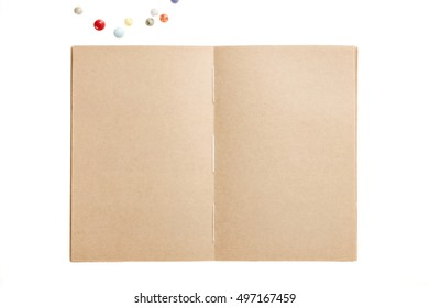 A old(vintage) empty(blank) spread note(recycled paper) with line, colorful button isolated white.