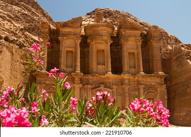 Oleander bush and the facade of the Monastery, one of the famous monuments of the ancient Nabatean city of Petra, Jordan.