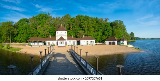 Olecko; Poland -  May 20, 2018: Panorama of the  city beach at the olecko lake great.  Historic the hill and wooden pier built from around 1930.