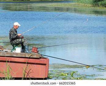 OLESHKY, KHERSON, UKRAINE - JUNE  11, 2017: fisherman waiting for fish