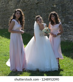 OLESKO UKRAINE 09 14 17: Happy wedding bride and bridesmaid at the Olesko Castle is located within the borders of the present-day Busk Raion in Ukraine.