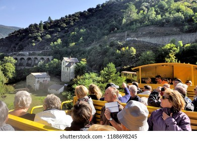 OLETTE, FRANCE - SEPTEMBER 4, 2018: The little yellow train of the Pyrenees Crossing mountain landscapes
