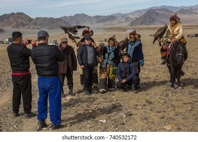 "OLGIY, MONGOLIA - SEP 30, 2017: Kazakh Golden Eagle Hunters at traditional clothing, during annual national competition with birds of prey ""Berkutchi"" of West Mongolia."