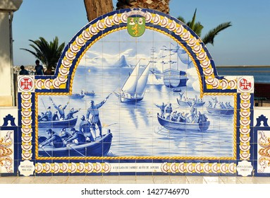 Olhao, Portugal - May 29, 2011: Bench of portuguese tiles of historical theme. Algarve region in southern Portugal