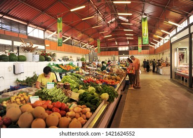 Olhao, Portugal - May 30, 2011: Fruits and vegetables in the famous market of Olhao a town with large fishing port in Algarve region, south of Portugal