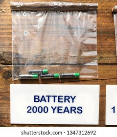 Olhos d'Agua, Algarve, Portugal - May 7, 2018: A note on decomposition process of old batteries