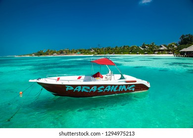 Olhuveli, Maldive-Jan 13, 2017: Fast parasailing boat in the sea at tropical Olhuveli island, south Male Atoll, Maldives.