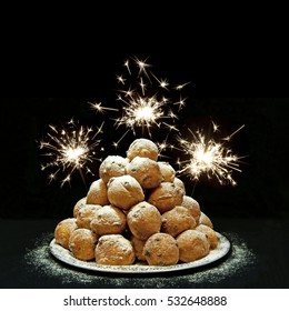 Oliebollen (Dutch doughnuts) and fireworks, traditional Dutch pastry for New Year's Eve