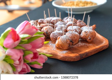 Oliebollen - Dutch traditional Dessert - Also known as Dutch Doughnuts or dutchies. Complimenting the Oliebollen is a bouquet of Tulips from Netherland