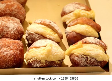 Oliebollen in store, traditional Dutch sweet food for New Year's eve in the Netherlands, Oliebollen are made of dough, like donuts. Berliner, stuffed with custard