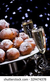 'Oliebollen', traditional Dutch pastry for New Year's Eve and two glasses of champagne.