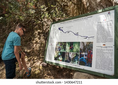 Oliena, Nuoro, Sardinia / Italy - 06 29 2016: Boy reading the information table about Spring Sorgenti di Su Gologone -  Monumento naturale in Oliena on an island of Sardinia