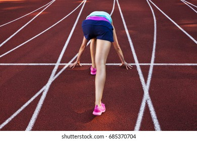 Olimpic games concept, sportswoman running on a racetrack