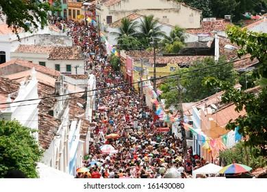 OLINDA, BRASIL - FEB 19: People celebrating the frevo carnival on February 19, 2012 in the old town of Olinda, Pernambuco, Brasil.