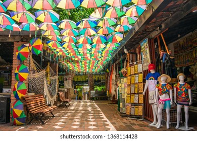 Olinda, Brazil - Circa April 2019: Market covered with typical colorful umbrellas from Pernambuco with souvenir shops in the historic center of Olinda